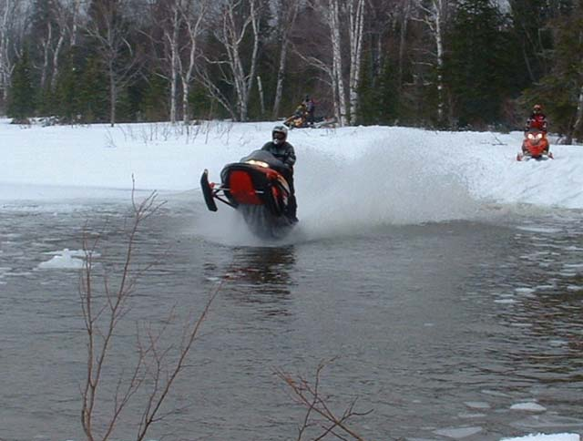 Snowmobiles Skipping Water 111